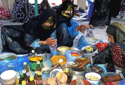 Bedouin women shopping in Ibra market Oman  OM14522